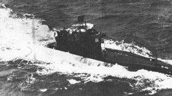 A U-Boat displays the black flag of surrender to an allied plane off the coast of Scotland.